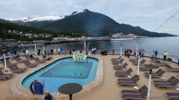 View of MS Amsterdam Seaview Pool with Ketchikan in the Background