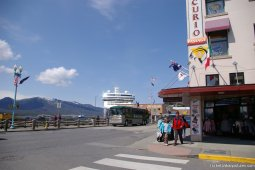 NCL Pearl in the distance on the street of Ketchikan.jpg